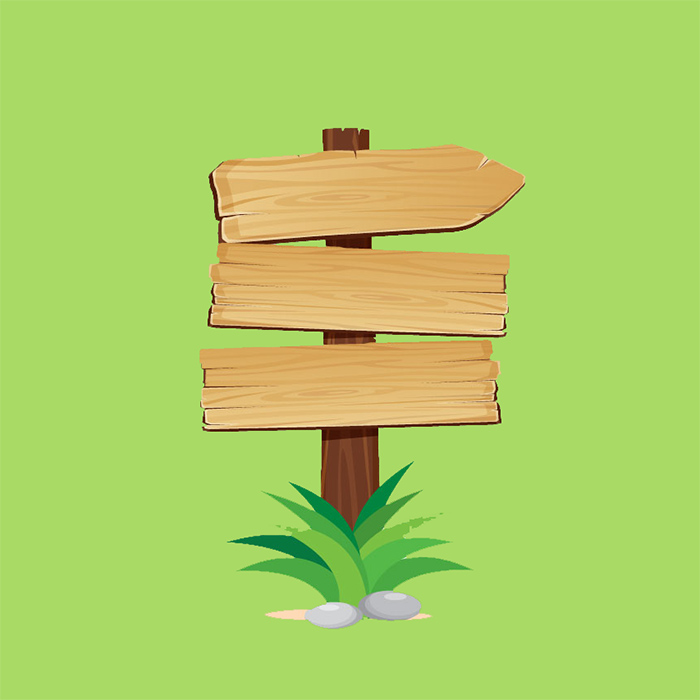 wooden signpost with green background